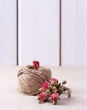 Ball of twine with  dried roses bouquet Royalty Free Stock Photos