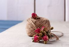 Ball of twine with  dried roses bouquet Royalty Free Stock Photography