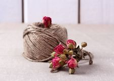 Ball of twine with  dried roses bouquet Royalty Free Stock Photo