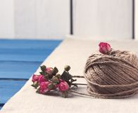 Ball of twine with  dried roses bouquet Stock Images
