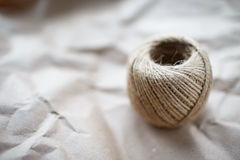 A ball of twine on kraft paper. A ball of twine on a crumpled kraft paper Stock Images