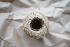 A ball of twine on kraft paper. A ball of twine on a crumpled kraft paper Royalty Free Stock Photo