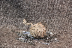 A ball of twine  and paper clips Stock Photo