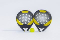 The ball and two beach tennis rackets are thrust in a snow snowdrift stock photos