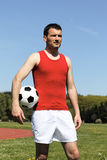 Ball under the arm Stock Photography