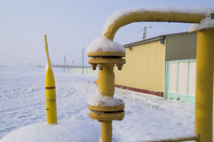 Ball valve on a gas pipeline covered with snow Stock Photography