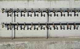 Ball valves connected to a pipes waiting to be connected to new homes under construction.  Royalty Free Stock Photography