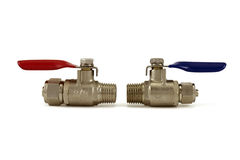 Ball valves. Two ball valves with red and blue handles isolated on a white background Stock Photo