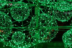 Green electric garland. Ball shape royalty free stock image
