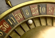 Playing on a vintage roulette Royalty Free Stock Image