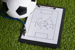 Ball; whistle and soccer tactic diagram on pitch Royalty Free Stock Photos