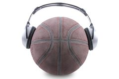 A ball on white background with headphones Royalty Free Stock Images