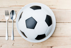 Ball on white plate Royalty Free Stock Photos