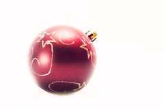Ball in white. Red christmas ball with stars in white background Royalty Free Stock Images
