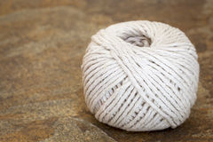 Ball of White String or Twine on Stone Background Royalty Free Stock Photo