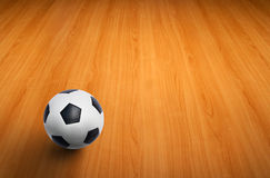 A ball on wooden floor Royalty Free Stock Photos