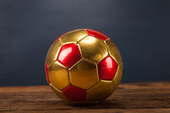 Ball on wooden table Stock Photography