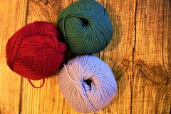Ball of wool colored on wood material fashion clothing lamb texill. Work handmade dress accessories table stock images