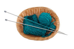 Ball of wool and knitting in the basket for needlework on a whit Royalty Free Stock Photos