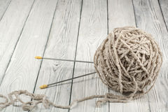Ball of wool with spokes for handmade knitting on wooden table. Knitting wool and knitting needles. Ball of wool with spokes for handmade knitting on wooden royalty free stock photos