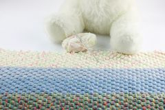 Ball of wool to make a crochet blanket. Near a white plush stock photography