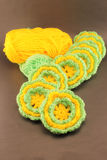 Ball of wool and woolen crochet flowers Royalty Free Stock Photo