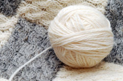 Ball of wool yarn and hand knitting Stock Photo