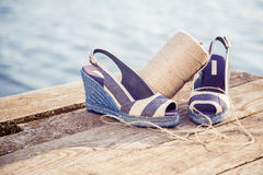 A ball of yarn around women sandals, shoes outdoors. A Stock Images