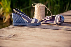 A ball of yarn around women sandals, shoes outdoors. A Royalty Free Stock Images