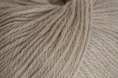 Ball of yarn closeup. Ball of white whool yarn cose up Stock Images