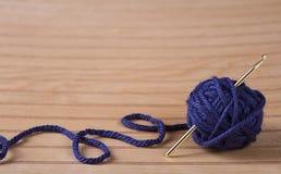 Ball of yarn with crochet needle Stock Images