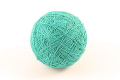 Ball of yarn. Ball of green yarn on white Royalty Free Stock Image