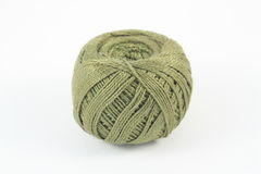 Ball of yarn. Ball of green yarn on white Stock Photography