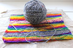 Ball of yarn and knitted fabric Stock Photos