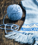 Ball of yarn and knitted scarf. Royalty Free Stock Photography