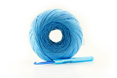 Ball of yarn and knitting. Blue ball of yarn and knitting on white background Royalty Free Stock Photos