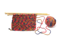 Ball of yarn and knitting needles. On a white background Stock Photography