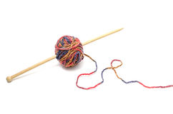 Ball of yarn and knitting needles. On a white background Stock Photos