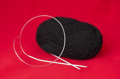 Ball of yarn and knitting skewers Stock Photography
