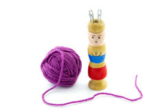 Ball of yarn and a knitting spool Royalty Free Stock Images