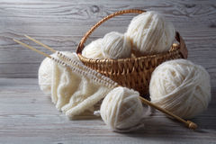 Ball of yarn and knitting on a table. Ball of yarn and knitting on a wooden table Royalty Free Stock Image