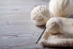 Ball of yarn and knitting on a table Royalty Free Stock Photography