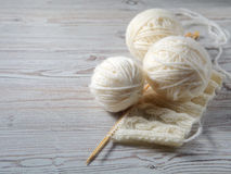 Ball of yarn and knitting on a table Stock Photo