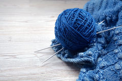 Ball of yarn and knitting on a table Royalty Free Stock Images