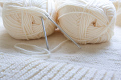 Ball of yarn and knitting on a wool background Royalty Free Stock Photos