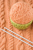 A ball of yarn are in the national dish and needles for knitting Royalty Free Stock Photography