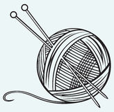 Ball of yarn and needles. Isolated on blue background Stock Photography