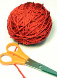 Ball of Yarn & Scissors. This is a close up image of a red ball of yarn and a pair of scissors royalty free stock images