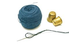 Ball of yarn and two thimble Royalty Free Stock Photos