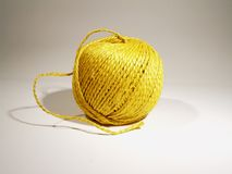Ball of yellow string. On white background stock image
